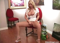 Alison Angel Plays in a chair